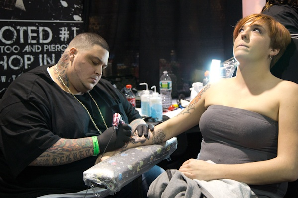 Lindsay Hines from Belmar N.J. is getting a tattoo. (Kimberly Paynter/WHYY)