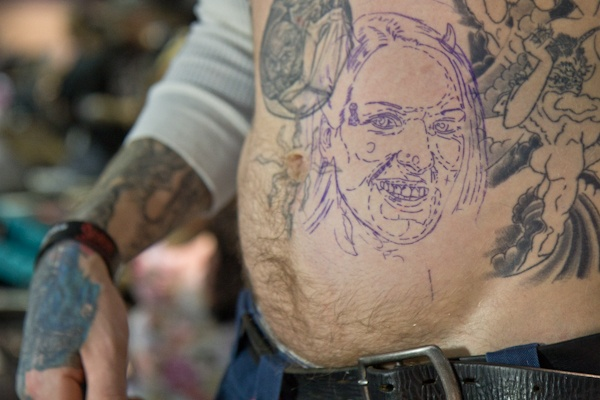 Tattoo artist Tom Hazelton is preparing to get a tattoo of his fiance, Candy.  (Kimberly Paynter/For NewsWorks)
