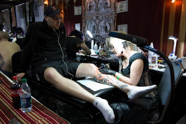 Dan Kowalczyk from Edison, N.J., has known D.C. tattoo artist Cynthia Rudzis for almost as long as she's been tattooing. (Kimberly Paynter/WHYY)
