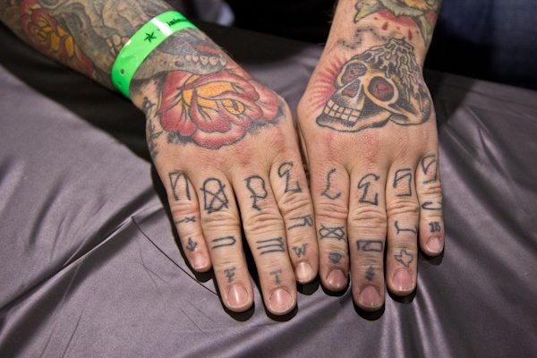 Tattoo artist Matt Morren from Austin, Texas has just arrived at the convention and is waiting for his first customer.  (Kimberly Paynter/WHYY)