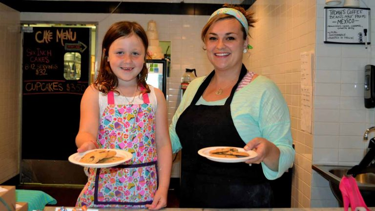 Sienna Storey, 6, and Elizabeth Paradiso of Sweet Elizabeth's Cakes will be selling chocolate chip cookies all day Friday, June 28, to benefit the Leukemia and Lymphoma Society. (Joel B. Frady/for NewsWorks)