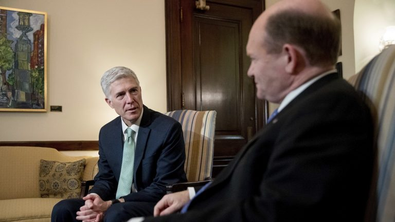 Supreme Court Justice nominee Neil Gorsuch, left, meets with Sen. Chris Coons, D-Del. on Capitol Hill in Washington, Tuesday in February. (AP Photo/Andrew Harnik)