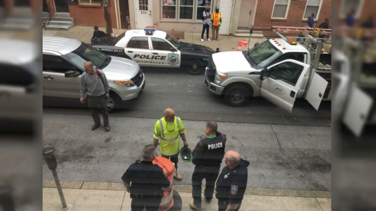 Police investigate a shooting on 7th St. Wednesday afternoon.  A 13-year-old boy was arrested after a brief chase. (Mark Eichmann/WHYY)