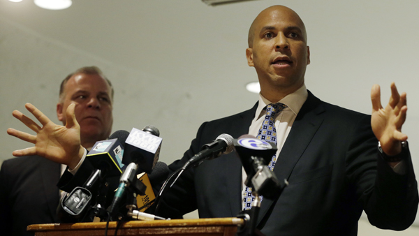 N.J. Senate President Stephen M. Sweeney listens, as Senate candidate Newark, N.J., Mayor Cory Booker (foreground) addresses a gathering of supporters at an event in Deptford Township. (AP Photo/Mel Evans, file)