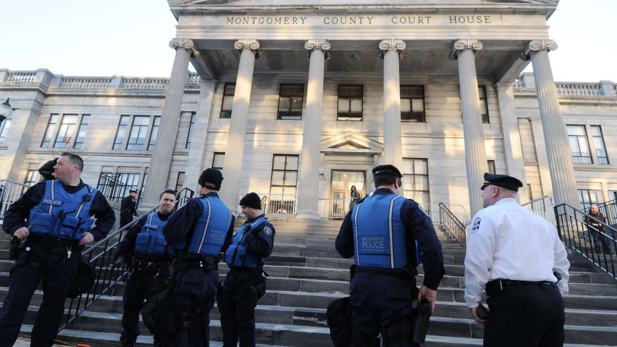 Police await the arrival of Bill Cosby outside the Montgomer County Courthouse in Norristown Tuesday morning.