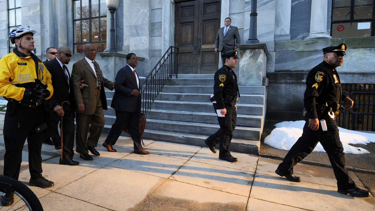 Police clear the way for Bill Cosby as he walks to the Montgomery County Courthouse for the first day of hearings in his sexual assault trial.