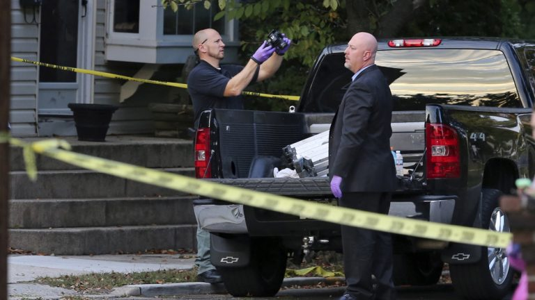 New Jersey's violent crime rate decreased slightly from 2014 to 2015 even though murders increased over the same period. In this Oct. 13, 2015, file photo, officers from the Camden County prosecutor's office investigate a homicide in Haddon Township. (AP Photo/Mel Evans, File)