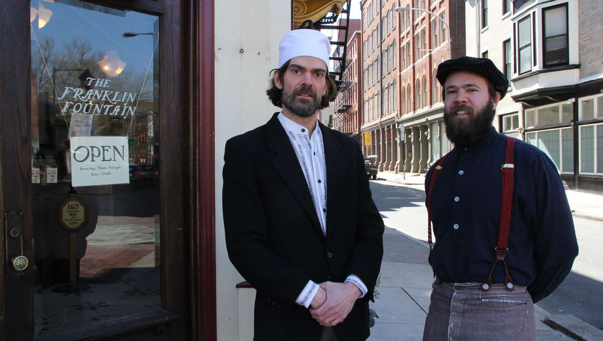 Ryan Berley (left), with his brother Eric, owns the Franklin Fountain in Old City, where crime is down.