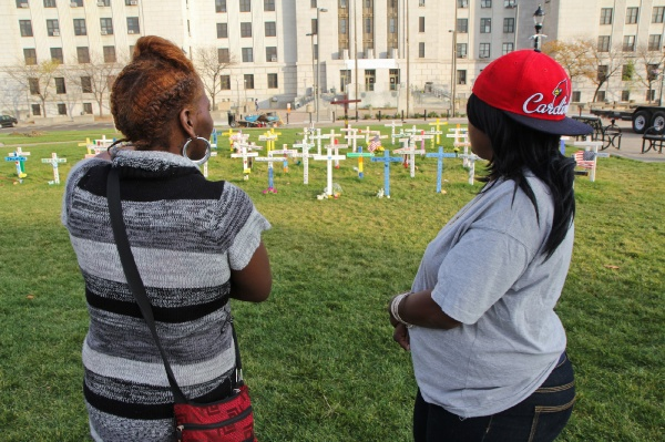 <p>Lifetime Camden residents Angel Moore and Tazamakia Johnson are especially saddened by the amount of women represented in the memorial. (Kimberly Paynter/for NewsWorks)</p>