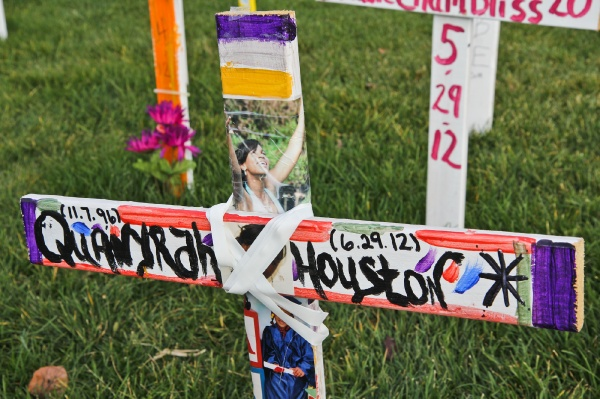 <p>Crosses on the Camden City Hall front lawn represent victims of homicide in the year 2012. Many are personalized to memorialize the slain. (Kimberly Paynter/for NewsWorks)</p>