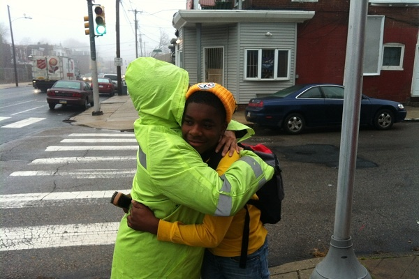<p><p>Taylor hugs a student outside the East Germantown school. (Kiera Smalls/for NewsWorks)</p></p>