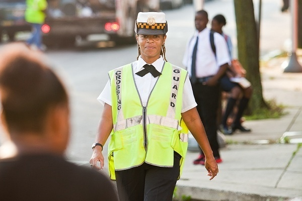 <p><p>Crossing guard Wanda Taylor watched over the intersection of Sprague St. and E. Chelten Ave. on the first day of school at Pastorius Elementary. (Brad Larrison/for NewsWorks)</p></p>
