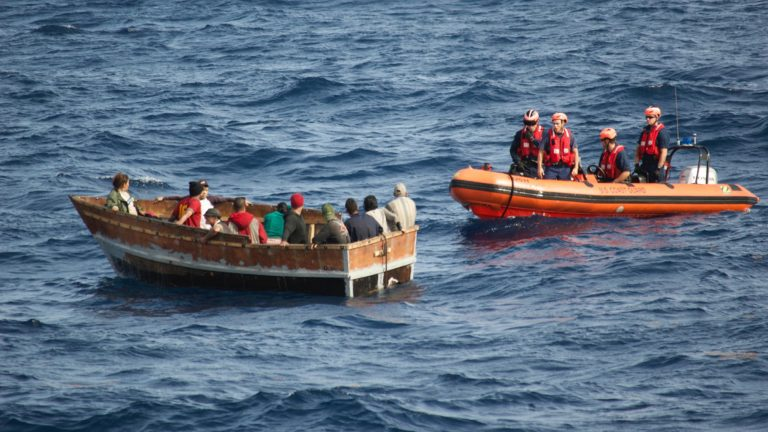 In 2014, crew members of the  U.S. Coast Guard Cutter Knight Island approach a boat with 12 Cuban migrants southwest of Key West, Florida.  (AP Photo/U.S. Coast Guard)