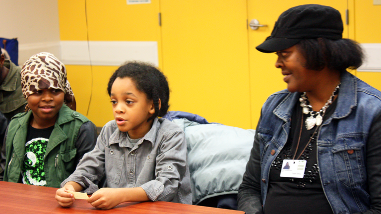 Donna Washington and her kids, Christenea and Christopher Archer, take part in a program at Child and Family Connections in Philadelphia. (Photo by Judy Kuo)