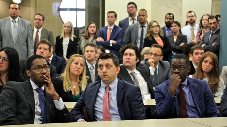 Employees of the Philadelphia district attorney's Office gather to hear first Assistant District Attorney Kathleen Martin talk about plans for the future. (Emma Lee/WHYY)