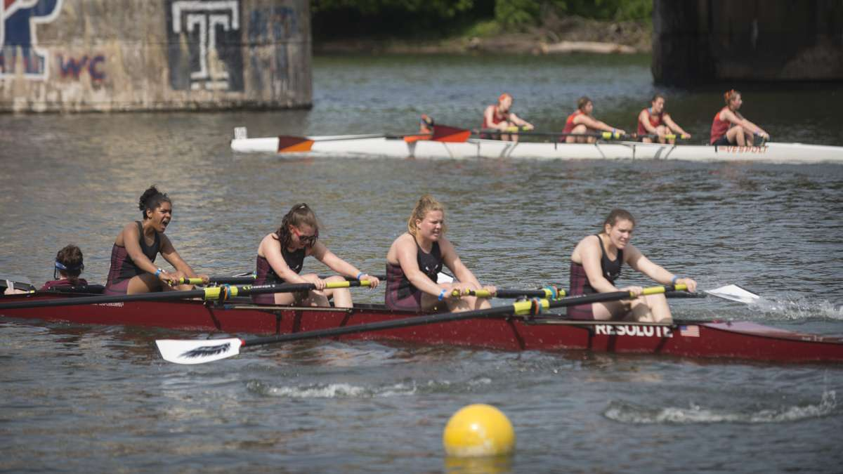 Exhausted contestants cross the finish line of the Dad Vail Regatta. (Branden Eastwood for WHYY)