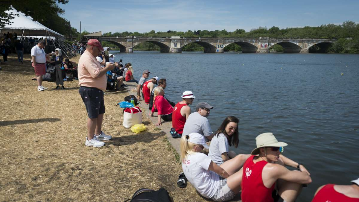 Spectators watch the 78th annual Dad Vail Regatta on the Schuykill River.