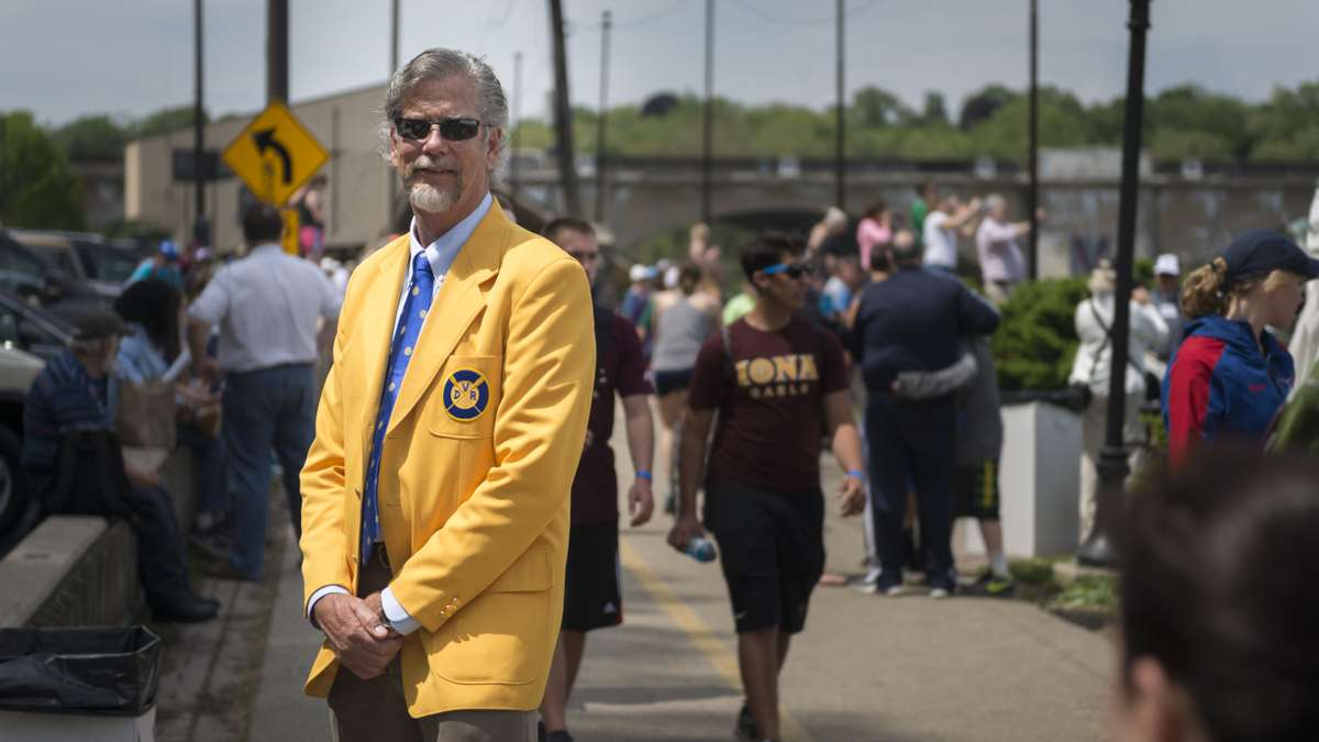 Braden J. Negaard poses in a yellow blazer that is presented to members of the Dad Vail Regatta community after a minimum ten years of involvement. Negaard has been involved with the Regatta for 43 years and is the second generation of his family to be part of the event. (Branden Eastwood for WHYY)