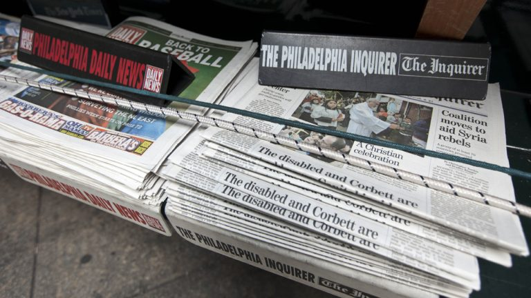 The Philadelphia Inquirer and Daily News newspapers sit on display on a newsstand. (AP Photo/Matt Rourke, file)
