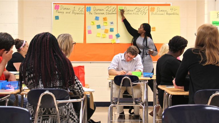 Consulting teacher Dana Singletary prepares a group of new teachers for the classroom during an orientation session at The Arts Academy at Benjamin Rush in Northeast Philadelphia. (Emma Lee/WHYY)