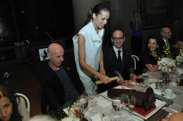 <p>&lt;p&gt;Artist Philippe Parreno, the exhibition designer of &quot;Dancing around the Bride&quot; (left), and&#xA0;Philadelphia Museum of Art Contemporary Art curator Carlos Basualdo&#xA0;(right) watch as a Saks Fifth Avenue model breaks a chocolate bachelor dessert (Photo courtesy of Kelly &amp; Massa Photography)&lt;/p&gt;</p>
