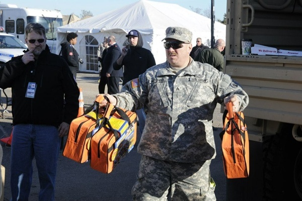 <p><p>Sgt Mark Mitchell unloads supplies at Midland Beach disaster relief distribution point. (US Army photo by Sergeant 1st Class William Gates, courtesy 101st Public Affairs Detachment)</p></p>