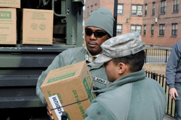 <p><p>Sgt. Karl Reddick and Pfc. Joseph Castrogriovanni unload supplies at the Hammel Houses Community Center in Rockaway, New York. (US Army photo by Sgt 1st Class William Gates, courtesy DEARNG)</p></p>