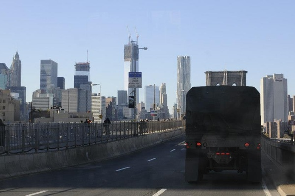 <p><p>Help arrives in New York City via the Brooklyn Bridge.  The Freedom Tower currently under construction can be seen in the background. (US Army photo by Sgt 1st Class William Gates, courtesy DEARNG)</p></p>