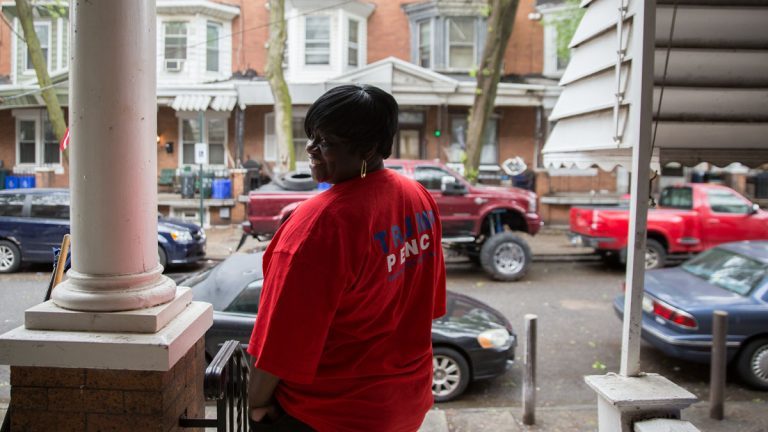 At her home in North Philadelphia, Daphne Goggins proudly wears her Trump Pence T-shirt.  Goggins said she first became a Republican in the 80's when then Governor Ronald Reagan was running for president. (Lindsay Lazarski/WHYY)