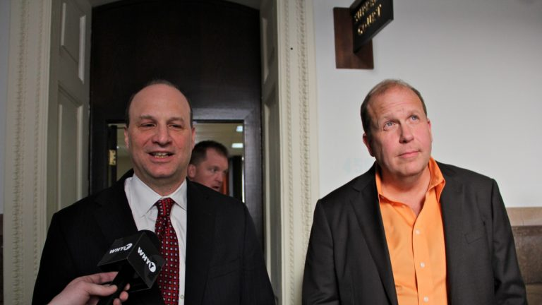 Attorney Martin Black (left) and state Sen. Daylin Leach speak with reporters after arguments before the Pennsylvania Supreme Court. (Emma Lee/WHYY)