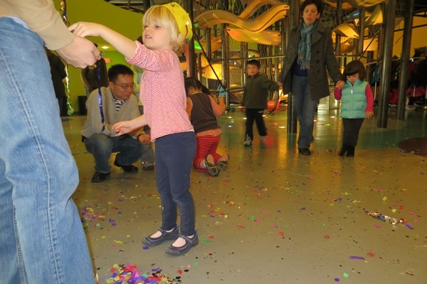 <p><p>Revelers collect confetti from New Year's Eve celebrations at the Delaware Children's Museum (Shirley Min/WHYY)</p></p>
