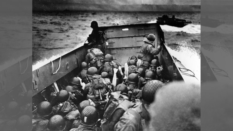 In this photo provided by the U.S. Coast Guard, a U.S. Coast Guard landing barge, tightly packed with helmeted soldiers, approaches the shore at Normandy, France, during initial Allied landing operations, June 6, 1944. These barges ride back and forth across the English Channel, bringing wave after wave of reinforcement troops to the Allied beachheads. (AP Photo)