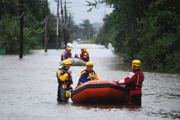 Teams went out in the swollen Christiana River Sunday looking for people who might be stranded from the flooding caused by Hurricane Irene. (John Jankowski/For Newsworks)
