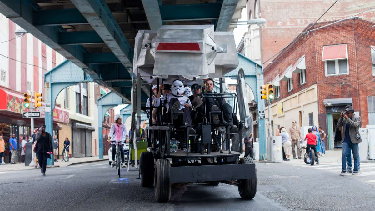 A Star Wars-themed vehicle makes its way down Front Street.