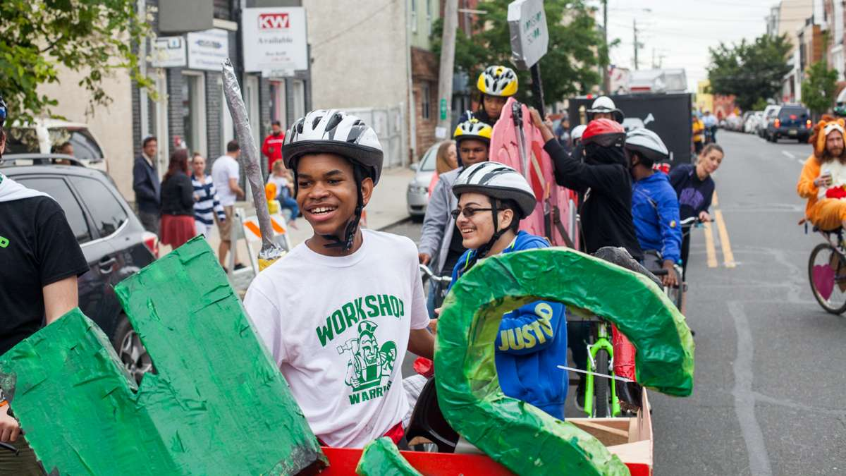 Students from the Workshop School in West Philadelphia wait to restart the ride through Fishtown