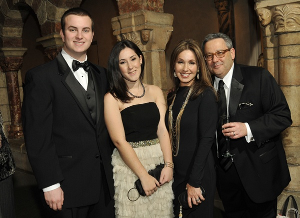 <p><p>Gala planning committee chair and Devereux parent Shaye Schloss (second from right) with her husband, David (right), daughter Isabel (center) and guest Matthew Haas. (Photo courtesy of Phil Stein Photography)</p></p>