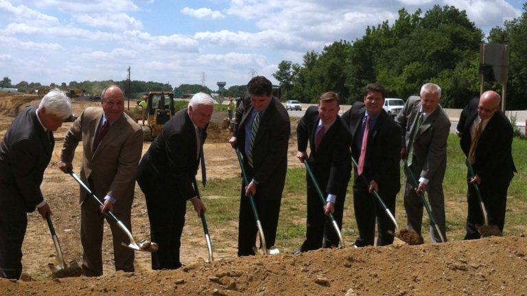 Gov. Tom Corbett and other officials picked up shovels for a photo op at the opening ceremony for the Pennsylvania Turnpike to I-95 interchange.