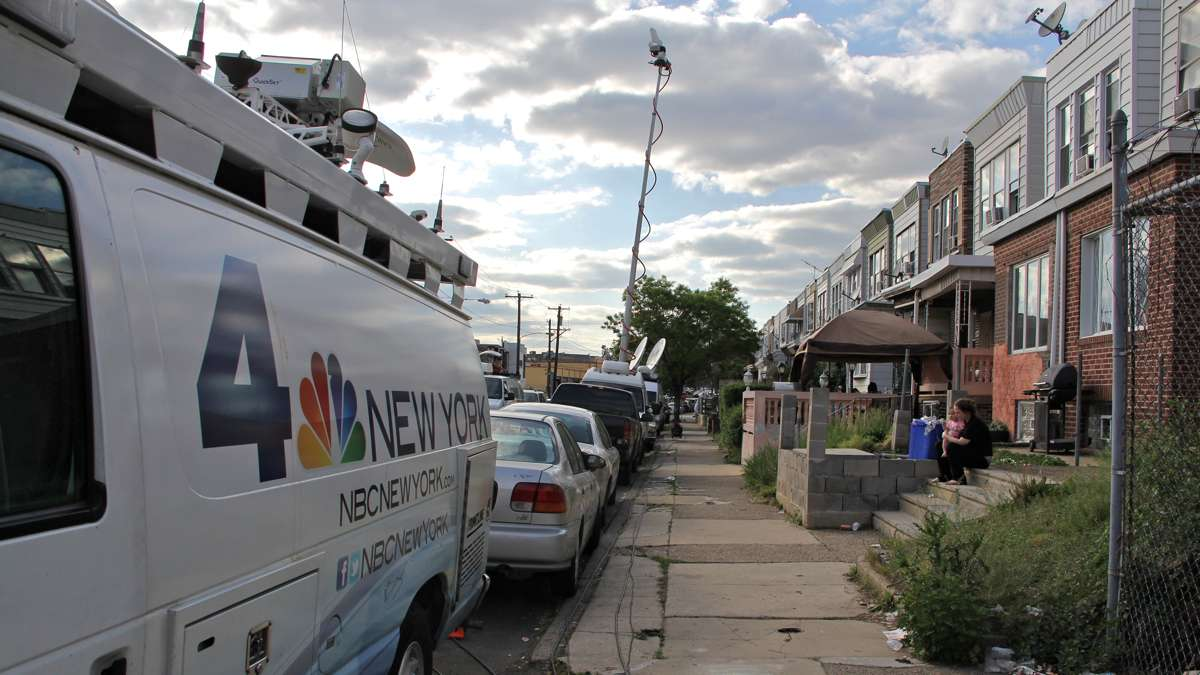 Media vans fill East Pike Street leading to the accident scene.