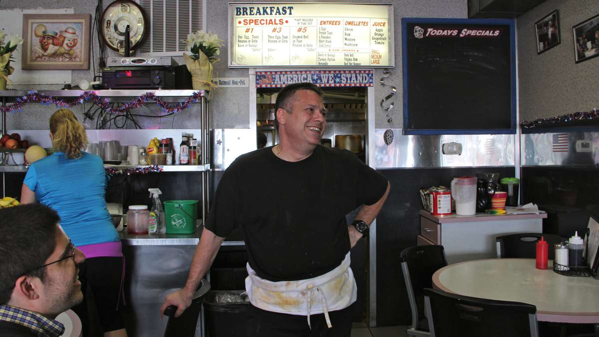 Ron Bordone, proprietor of Pete's Clown House, takes a brake from working the grill.