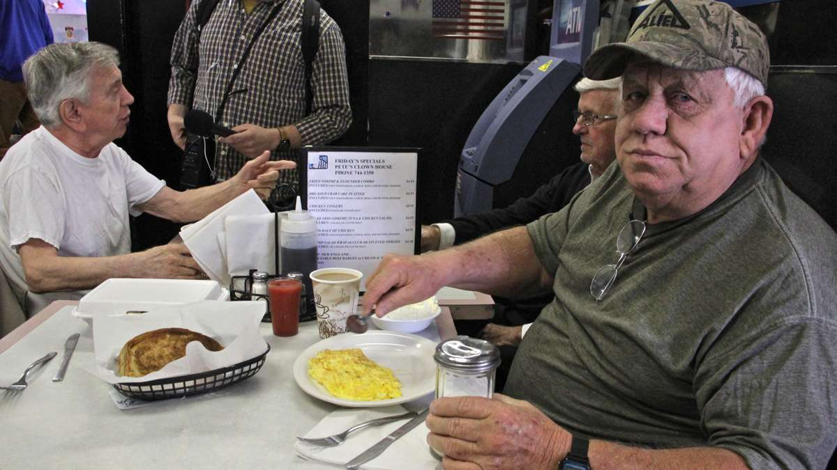 Clown House regular Ken Cooper settles in for eggs and grits with old friends.
