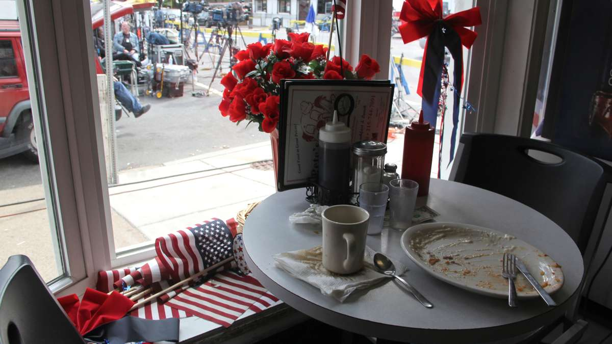 Patrons at the Clown House diner can watch the comings and goings of journalists, emergency responders and investigators while enjoying their creamed chipped beef and coffee.