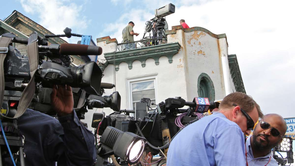 Jon Powell allowed camera crews and photographers to take up positions on his roof, which overlooks the site of the train wreck.