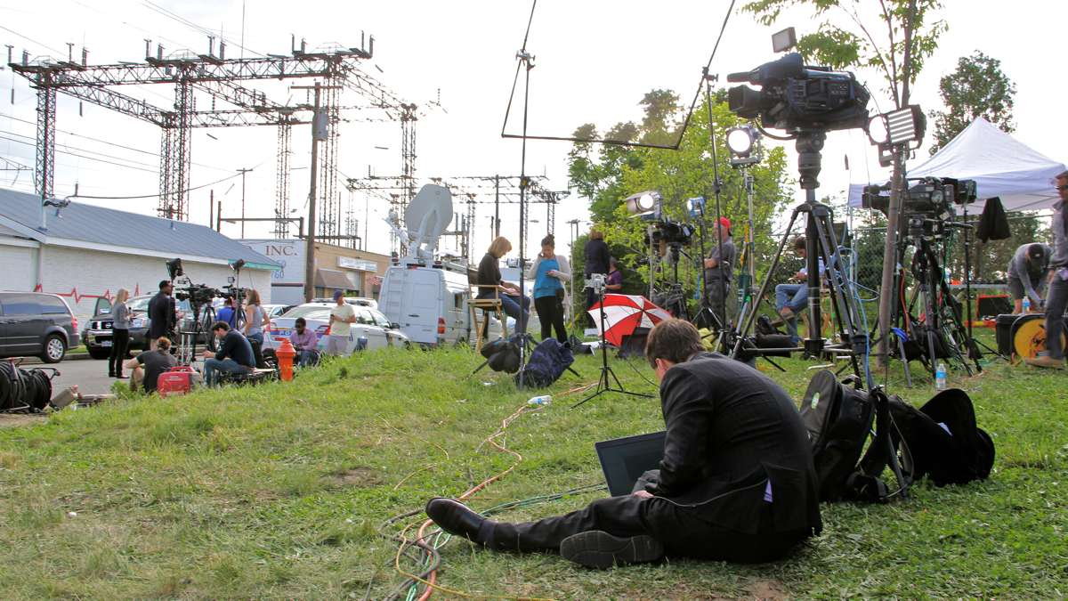 Journalists and camera crews set up camp on a vacant lot near the crash scene. (