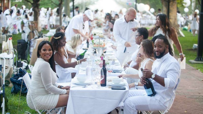 Participants in Dîner en Blanc bring their own tables, chairs, food, wine and tableware. (Brad Larrison for NewsWorks)