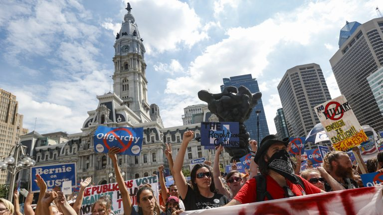 Supporters of Sen. Bernie Sanders, I-Vt., cheer during a protest near City Hall in Philadelphia, Wednesday, July 27, 2016, during the third day of the Democratic National Convention. (AP Photo/John Minchillo)