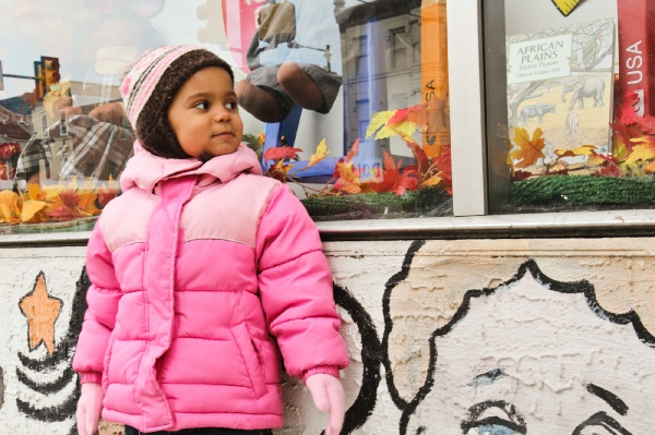 <p><p>Jayla Johnson, 3, who plays with dolls of her own, stares into the Philadelphia Doll Museum on N. Broad Street. Her mom promised her they'd be back for a visit another time. (Kimberly Paynter/for NewsWorks)</p></p>