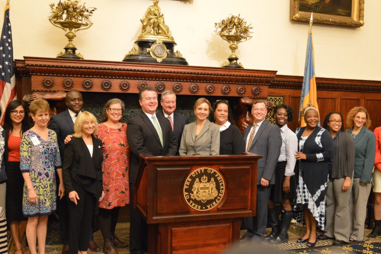 Award winners join Mayor Jim Kenney at a City Hall ceremony Tuesday. (Tom MacDonald/WHYY)