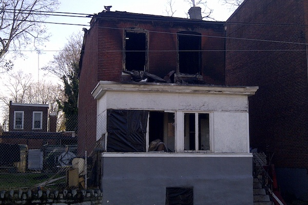 <p><p>Fire officials said a woman was found dead in a second-floor bedroom while another victim was transported to an area hospital where he would be pronounced dead later Wednesday morning. (Brian Hickey/WHYY)</p></p>
