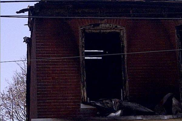<p><p>Fire damaged the building's roof such that it was possible to see through it. (Brian Hickey/WHYY)</p></p>