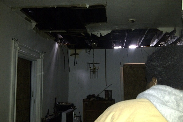 <p><p>Folk shows NewsWorks some of the damage in the home from which he, his wife, his five children and two dogs escaped Sunday night. (Brian Hickey/WHYY)</p></p>